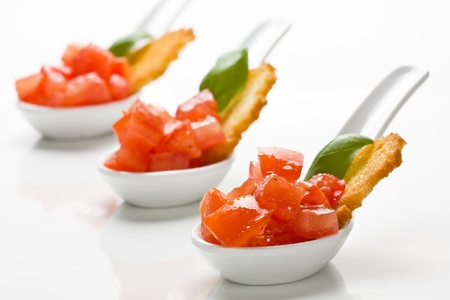 entrees: Delicious tomato bruschetta served in appetizer spoons Stock Photo