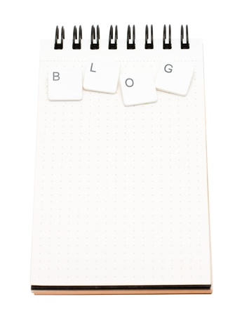 Empty notepad with keys spelling 'Blog' isolated on white background Stock Photo - 9666616