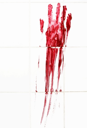 Bloody handprint with streaks on bathroom tiles photo