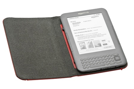 Munich, Germany - June 28th, 2011: German Amazon Kindle 3 3G with cover isolated on white background showing Amazon Kindle Shop home screen. Amazon released the Kindle 3 in Germany in April 2011