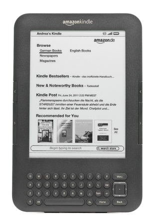 Munich, Germany - June 28th, 2011: German Amazon Kindle 3 3G isolated on white background showing Amazon Kindle Shop home screen. Amazon released the Kindle 3 in Germany in April 2011