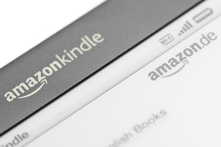 Munich, Germany - June 28th, 2011: Close up of the logo of the Amazon Kindle 3 3G showing logo of the Amazon Kindle Shop. Amazon released the Kindle 3 in Germany in April 2011