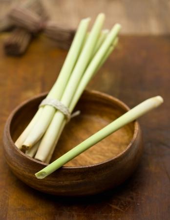 Fresh organic lemongrass bundle in wooden bowl
