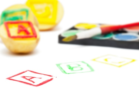 Potato stamps with ABC letters - back to school or learning concept photo