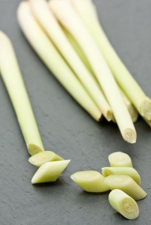 Fresh cut organic lemongrass on cutting board