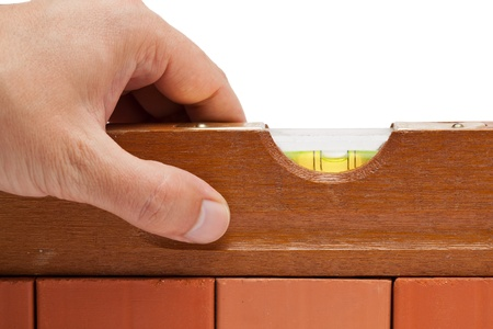 Craftsman measuring a brick wall with a spirit level Stock Photo - 10256903