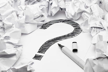 lack: Question mark in the middle if crumpled papers - lack of inspiration concept