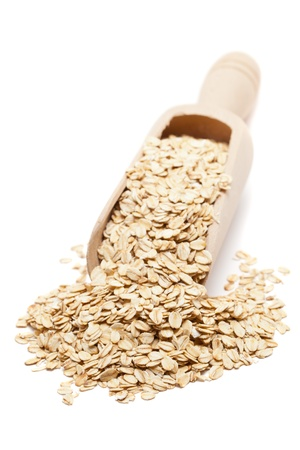 oatmeal: Oat flakes in wooden scoop isolated on white background Stock Photo