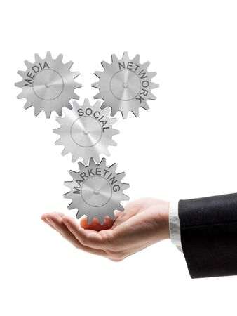 Business man holding gear wheel concept of social network, media and marketing photo