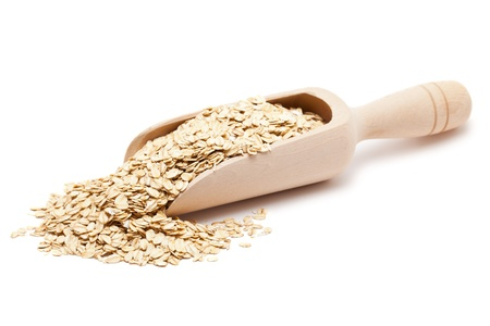 oat: Oat flakes in wooden scoop isolated on white background Stock Photo