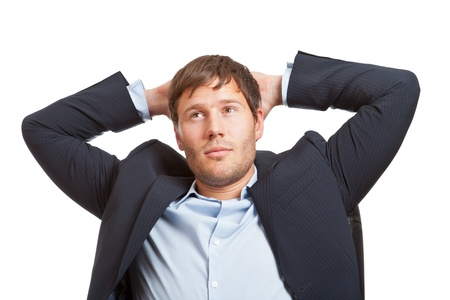 Young male business man thinking or dreaming photo