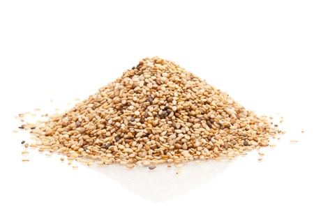pile up: Heap of organic natural sesame seeds over white background