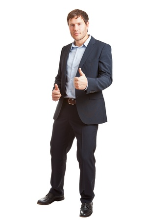 Successful young business man with thumbs up isolated on white background photo
