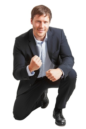 Young business man happy about achievement isolated on white background photo