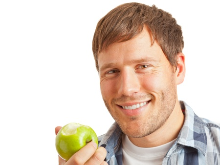 Young man eating an apple - healthy diet concept photo