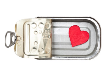 Little red heart in tin can isolated on white photo