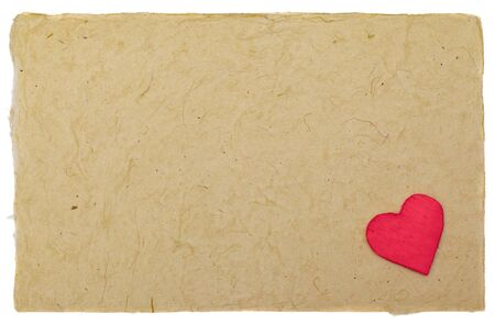 Little red heart on vintage paper with copyspace photo
