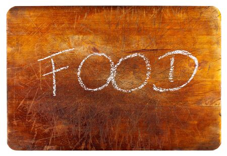 Food text on wooden cutting board isolated on white background photo