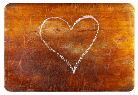 Heart shape on wooden cutting board isolated on white background - love for cooking concept Stock Photo - 11956118