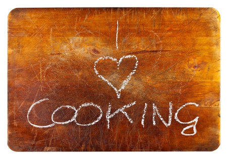 I love cooking text on wooden cutting board isolated on white background photo