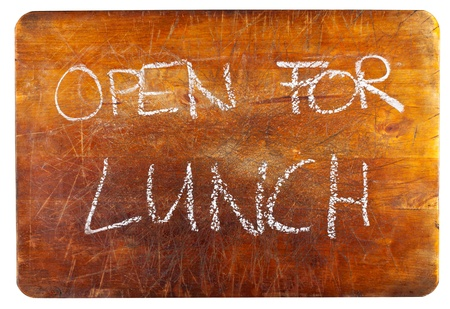 Open for lunch text on wooden cutting board isolated on white background photo