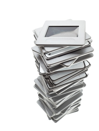 Stack of transparency slides over white background photo