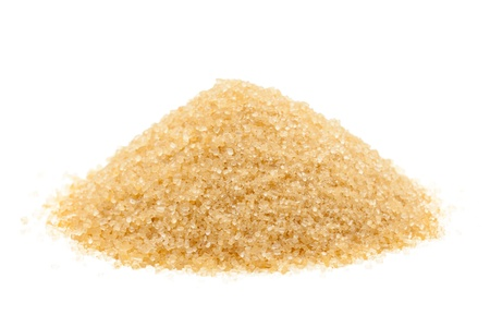unrefined: Heap of organic brown cane sugar over white background