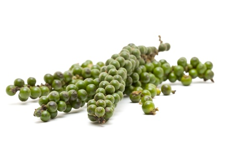 unprocessed: Unprocessed fresh green peppercorns over white background