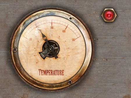 themed: Steampunk themed vintage brass and copper gauge with red lamp on metal background Stock Photo