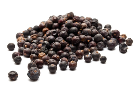 Heap of Juniper Berries on white background Stock Photo