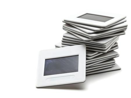 Pile de diapositives de transparence sur fond blanc
