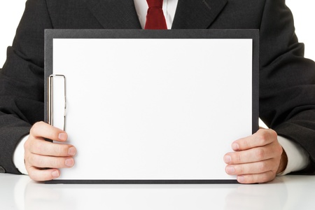 Businessman holding clipboard with empty piece of paper for copy or images photo