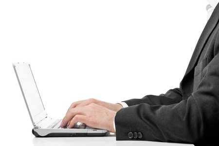 Businessman typing on laptop photo