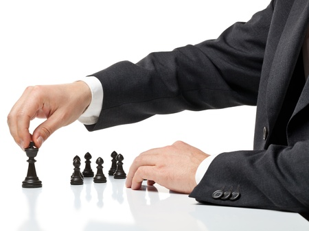 Business man moving chess figure with team behind - strategy or management concept Foto de archivo