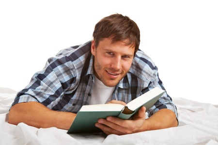 Young student reading a book, looking at camera, smiling Stock Photo - 12962865