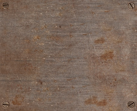Rusty grunge metal background plate with screws Stock Photo - 13041059