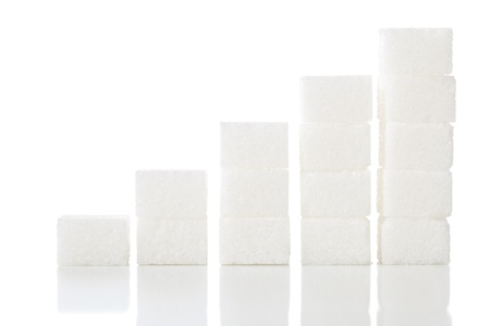 Ascending stacks of sugar cubes - high blood sugar risk concept Stock Photo
