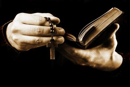 rosary beads: Man praying