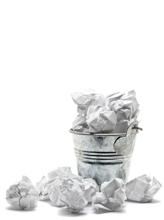 crumbled: Metal waste basket filled with crumpled paper - waste or frustration concept