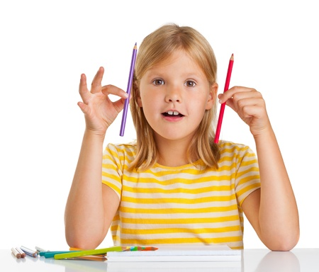 Young girl drawing with pencils isolated on white background photo
