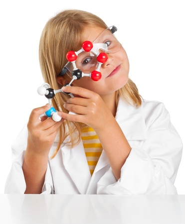 experiment: Cute young girl doing science experiements