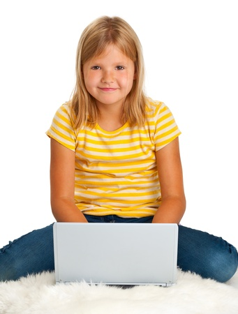 Young girl with laptop isolated on white background photo