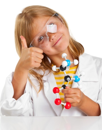 Cute young girl doing science experiements photo