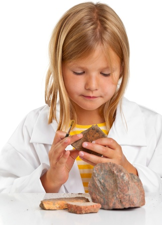 Cute young girl doing science experiement photo