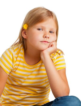 Young girl in yellow shirt isolated on white background photo