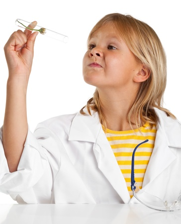 Cute young girl doing science experiment photo
