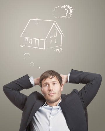 Young man thinking about his dream house photo