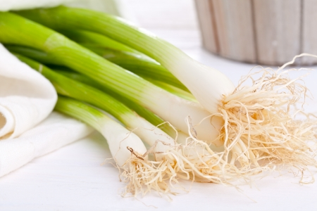 spring onions: Spring onions  green onions  on wooden table Stock Photo