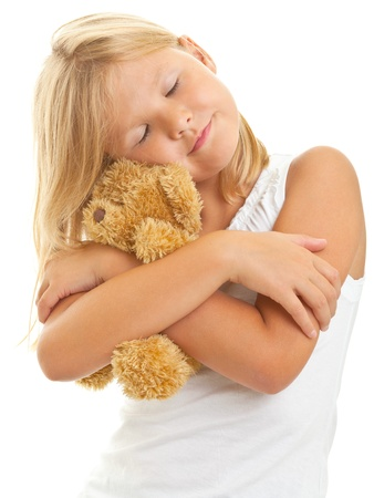 stuffed animals: Young girl with teddy bear isolated on white background