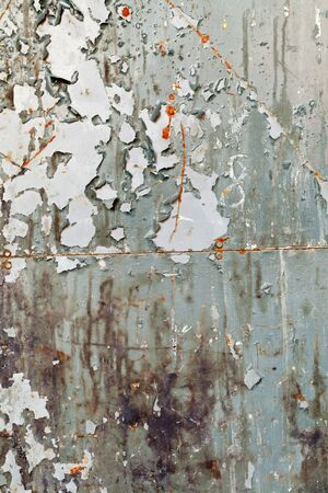 Old metal wall with paint peeling off photo
